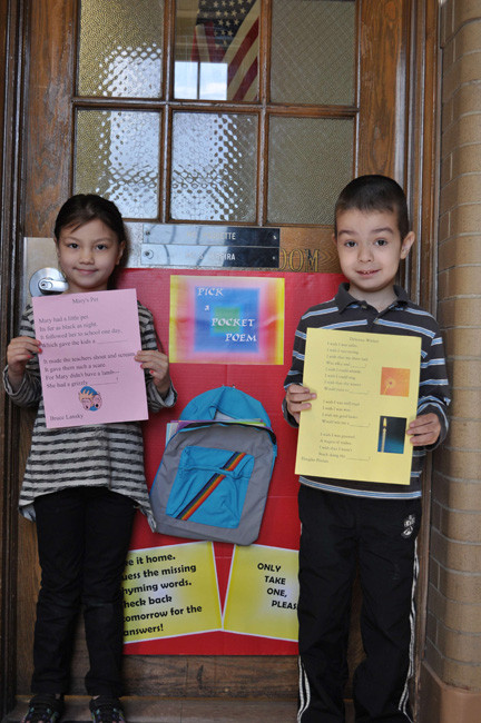 Kindergartners Cansu Kumas, left, and Kutay Melikoglu showed their poems off.