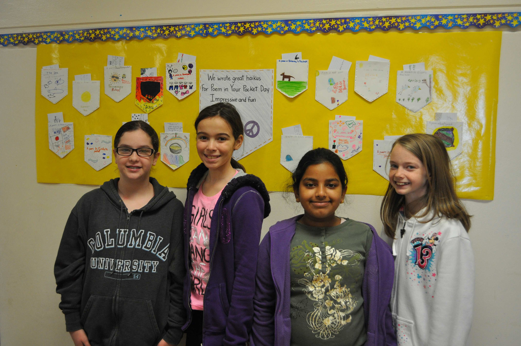 Emma Ward, left, Samantha Fels, Sumaiyah Khan and Emily Triquet, fifth-graders at Covert Avenue School in Elmont, showed off their haikus.