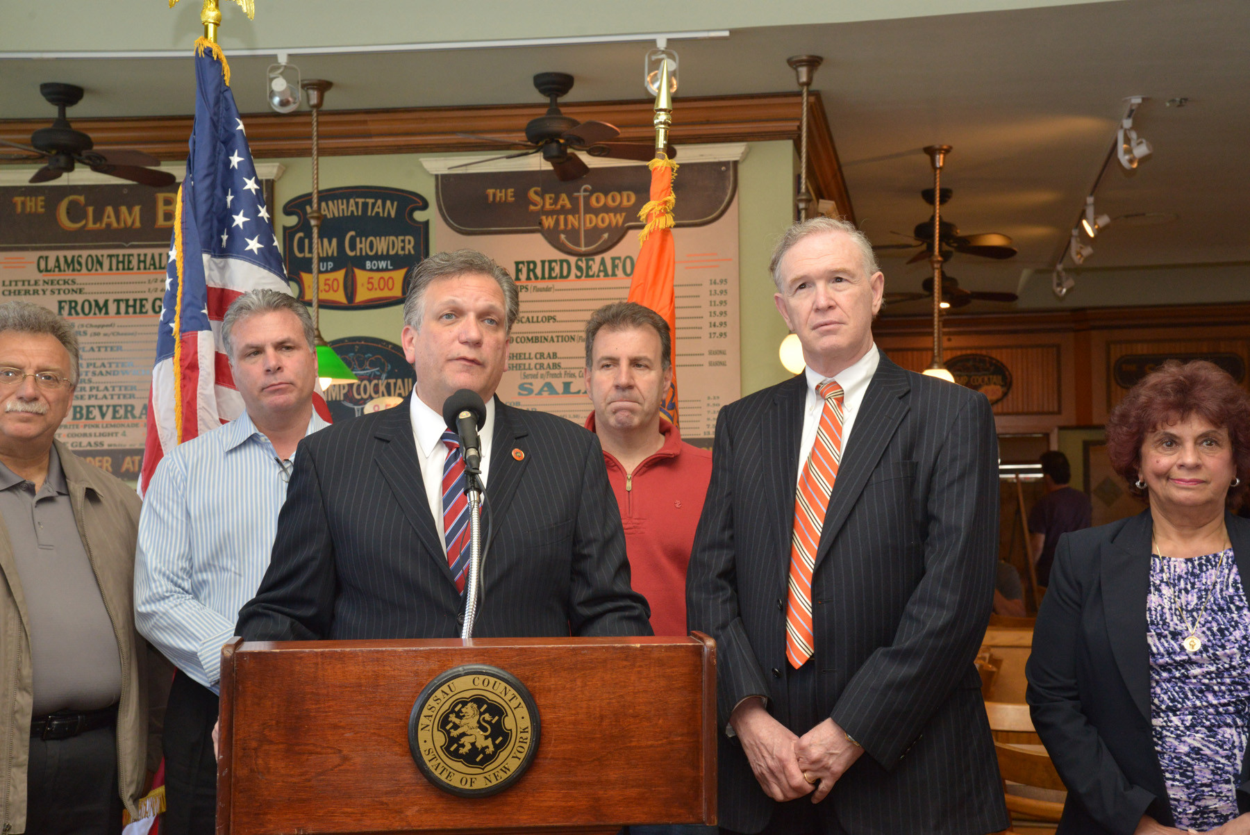 Nassau County Executive Ed Magano welcomed back Peters Clam Bar six months after it was devastated by Hurricane Sandy. With Magnano were, from left, co-owners Dominick DeSimone and Angelo Remunni, and County Legislator Howard Kopel.