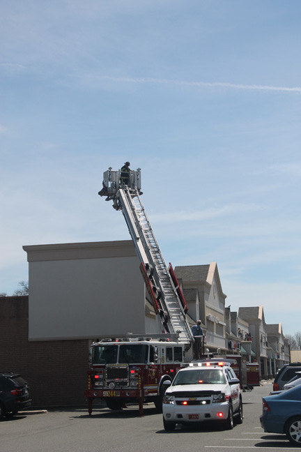 Oceanside firefighters check roof of stores in the Oceanside Mall on Tuesday, April 30.
