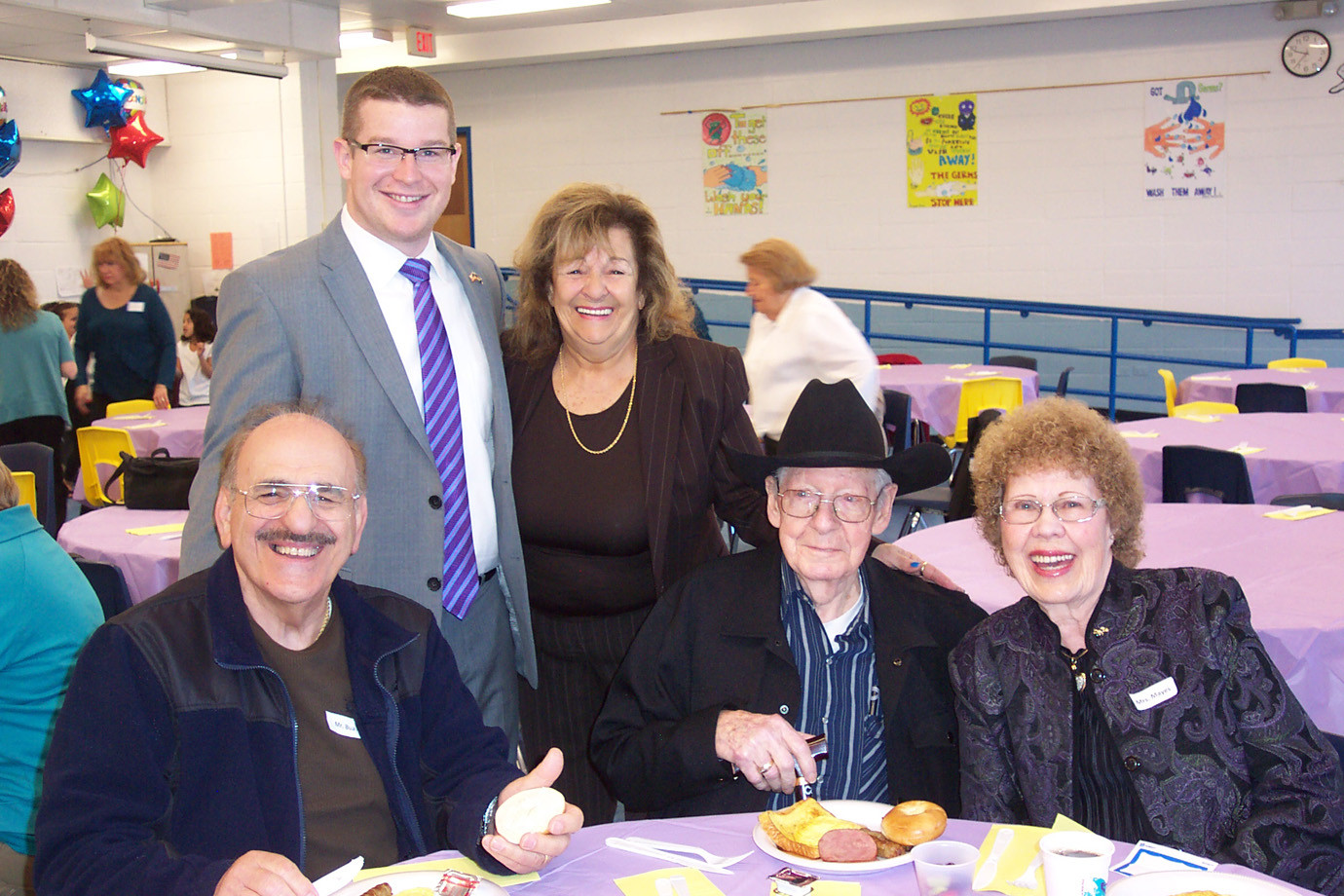 Island Park Schools Board of Trustee members Matthew Paccione and Nina Hargrove helped served breakfast to the seniors. They are pictured here with (l to r) Frank Bua, Maurice Mayes, and Nora Mayes.