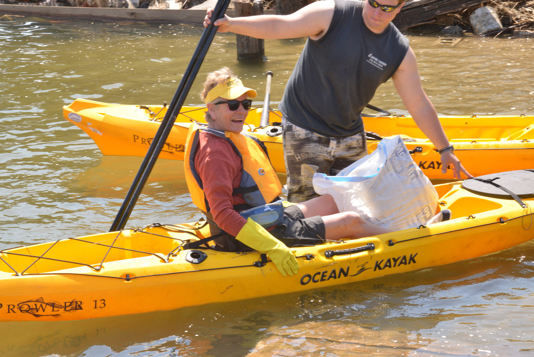 Gail Carlin at Empire Kayak in Island Park on Earth Day, Participants paddled free if they picked up detritus from water as they went.