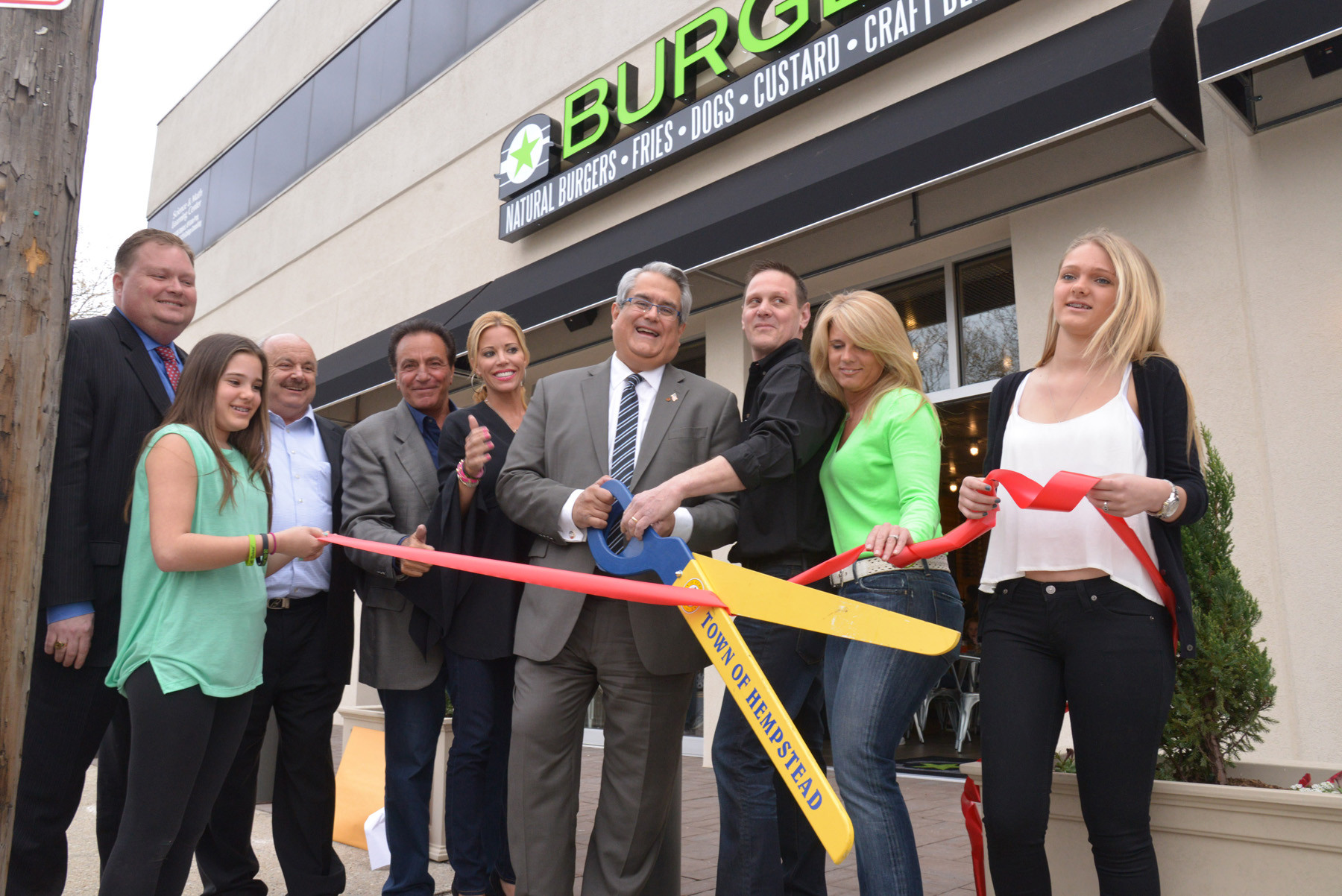 Chris Brown, representing County Executive Ed Mangano. Becky Sarro, Alex Berkovich. John and Dawn Rosati (owners), Town Leg. Anthony Santino, Mark and Maryanne Sarro (owners) and Jillian Sarro  at the  ribbon cutting  for the new Burgerfi.