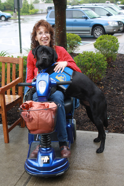West Hempstead resident Leslie Cohen with her assistance dog, Nardo.