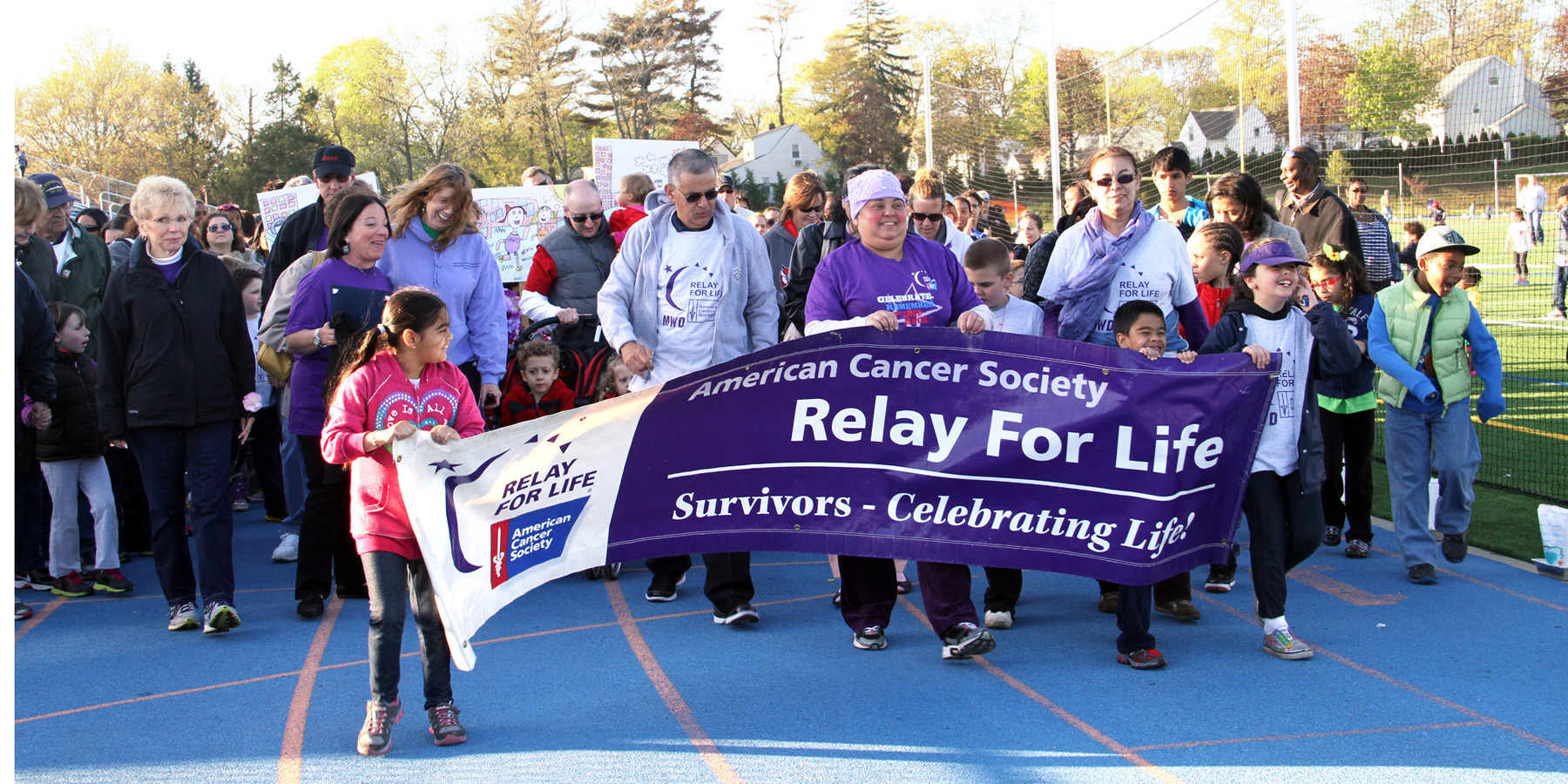 The Cancer survivors and their caregivers open the relay with the first lap around the track.
