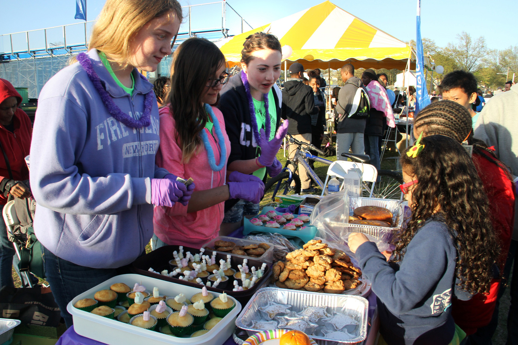Students from Herber middle schoool's national honor society help raise money by selling goodies.  From left, they are Catherine Walsh, Magda Kubik and Rosa Romano.