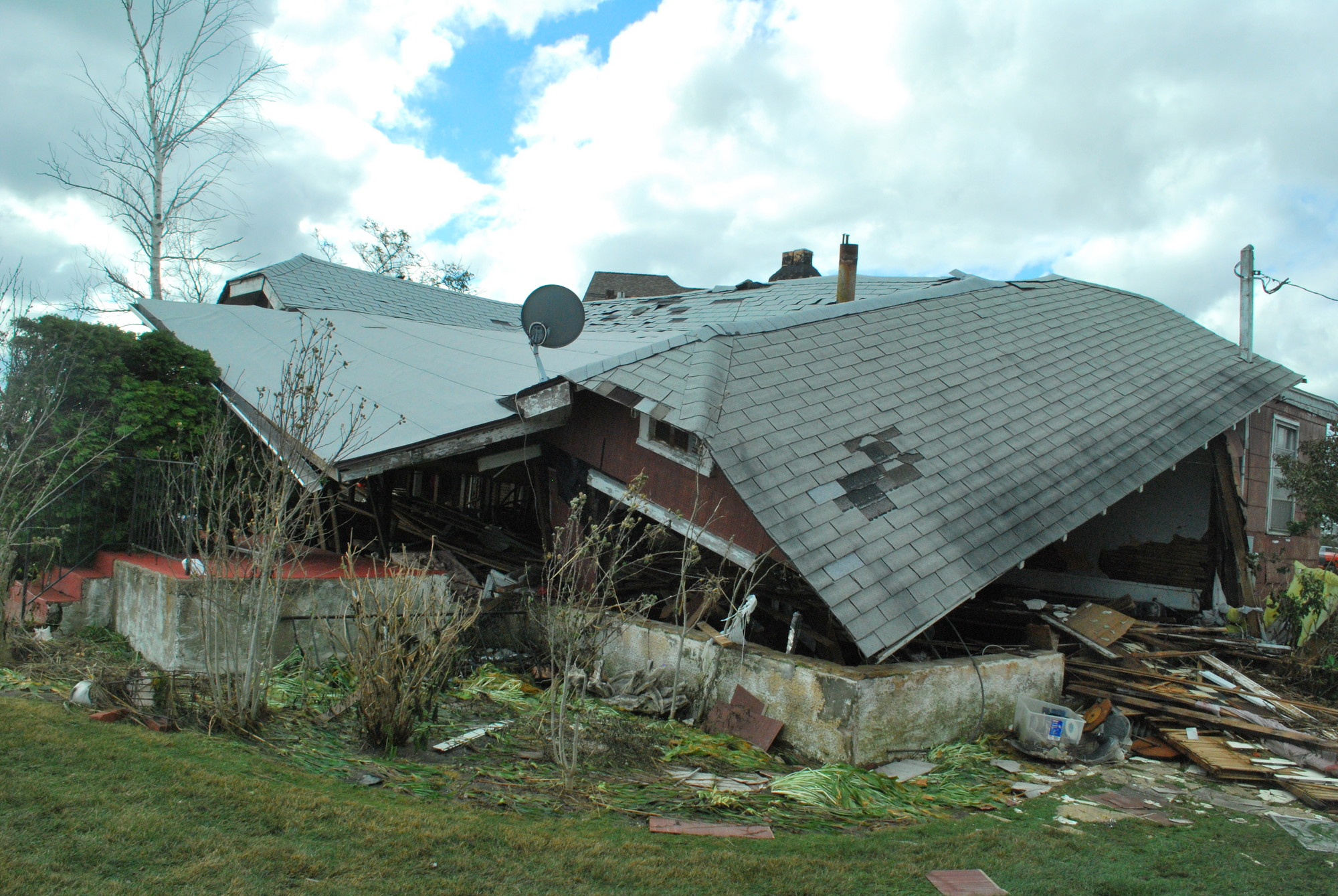 "Hurricane Sandy destroyed a house in Baldwin Harbor. County Executive Edward Mangano has announced a ""property-tax stabilization"" plan that should reduce taxes on properties that Hurricane Sandy damaged and hold property taxes level for others."