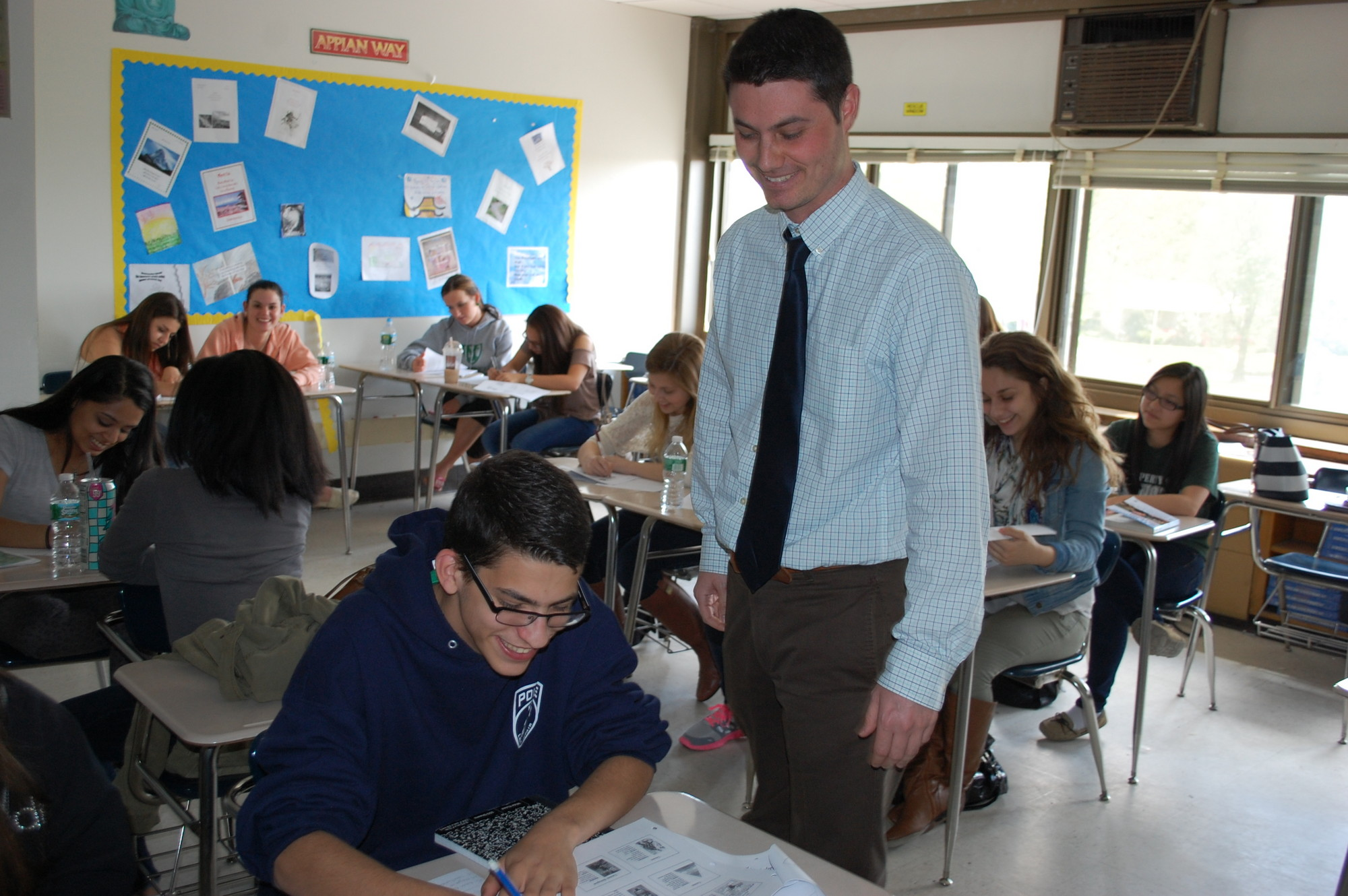 North High School teacher Dan Ryan meets with students in his Advanced Placement psychology class, who recently took the AP test. For some in the class, it was just one of five of the college-level exams they are taking this year.