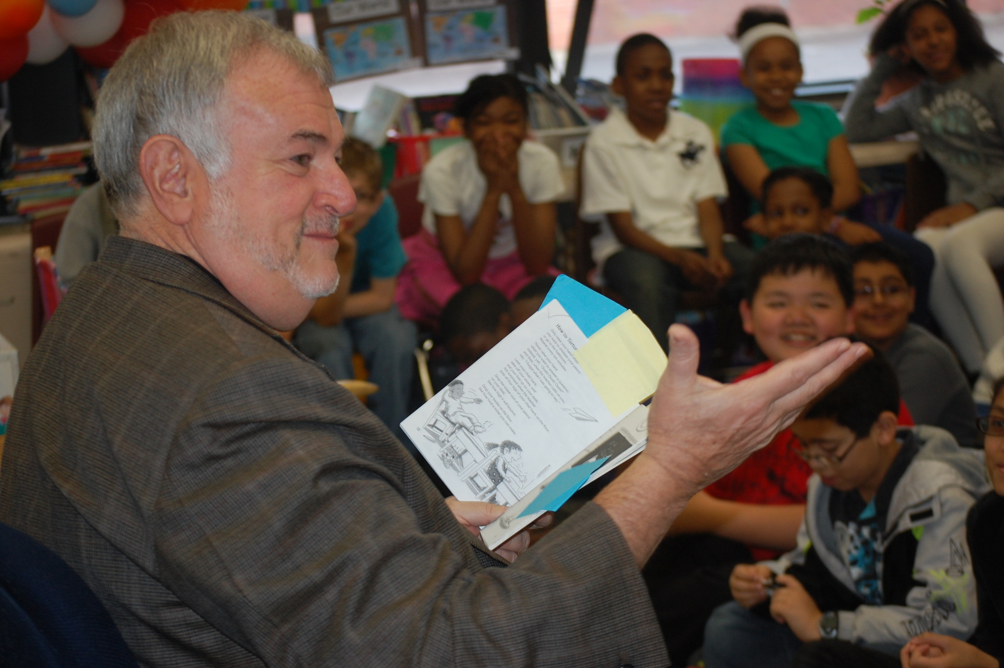 Roger Tilles, Long Island�s representative on the New York State Board of Regents, read poems to a fourth-grade class at Howell Road School on May 8.