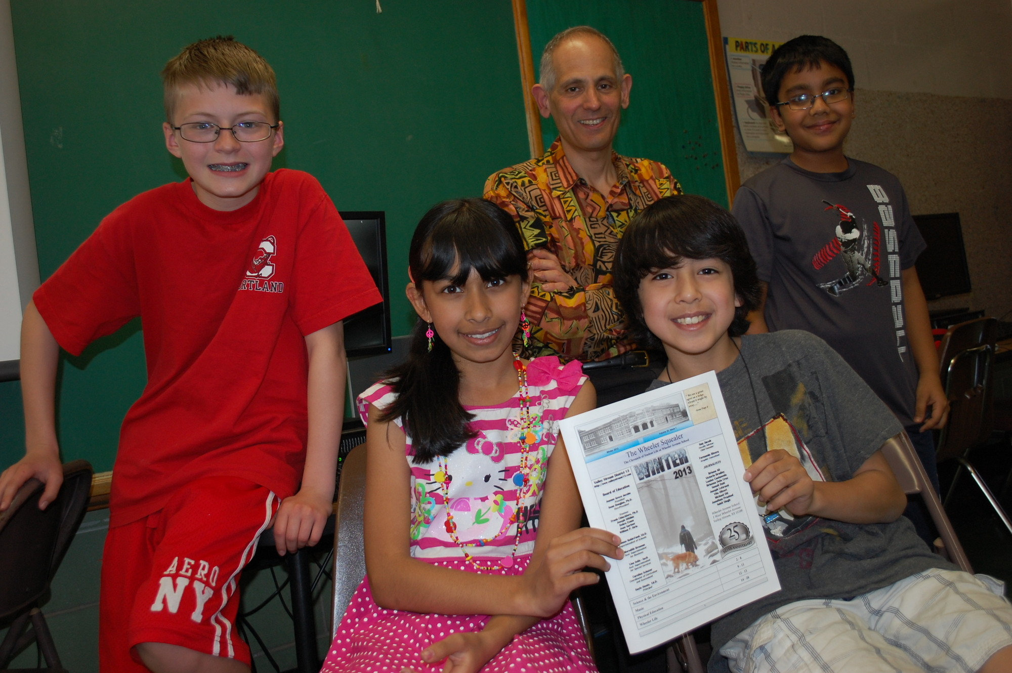 Wheeler Avenue School fifth-grader teacher Guy Jacob has been publishing the Wheeler Squealer for the pat 25 years. He is joined by members of this year's reporting staff, from left, Michael Ott, Solani Dutt, Vito Oliveri and Jonathan Prashad.