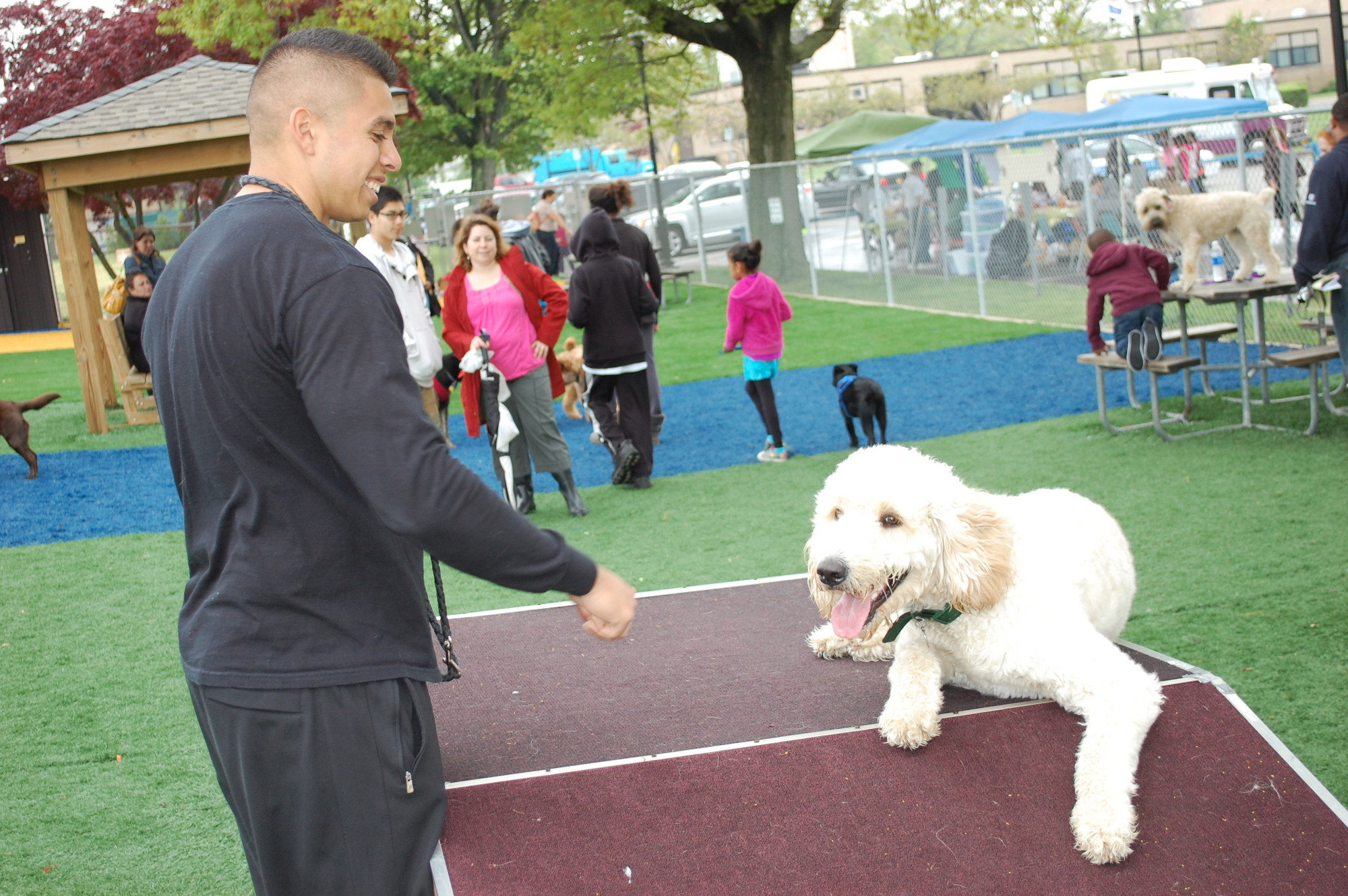 Claudio Barrios and his dog, Midas, enjoyed the dog park at the first anniversary celebration on May 11.