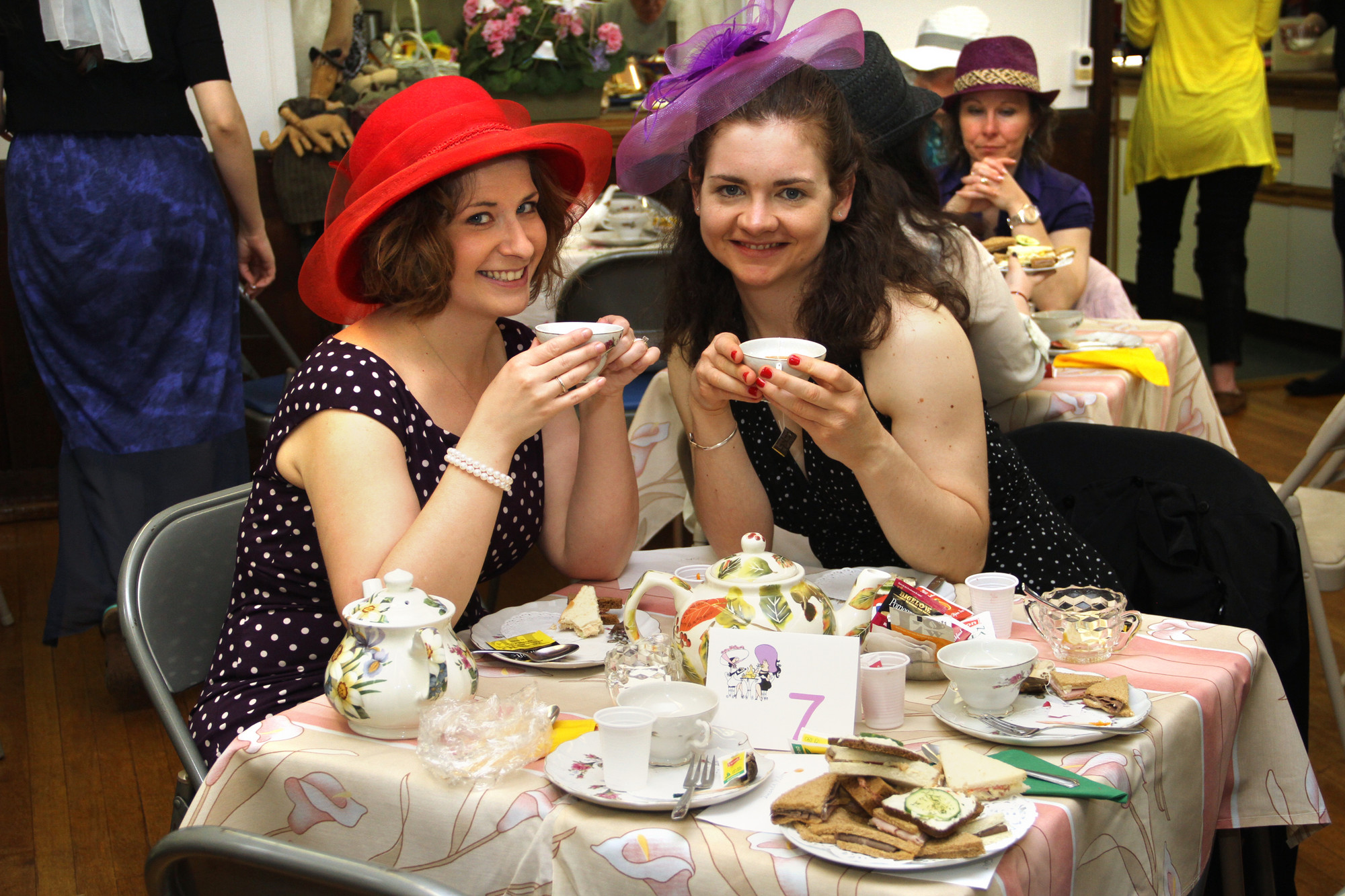 Katie Rosevear and Katherine Grimm enjoyed tea while wearing their fanciest hats.