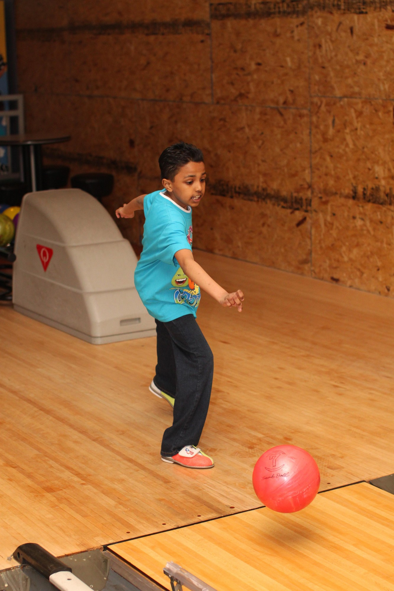 Hewlett High School senior Stephanie Gal organized a bowl-a-thon fundraiser for SIBSPLace. Joshua Lall, 9, showed his form as looked to knock down the pins.