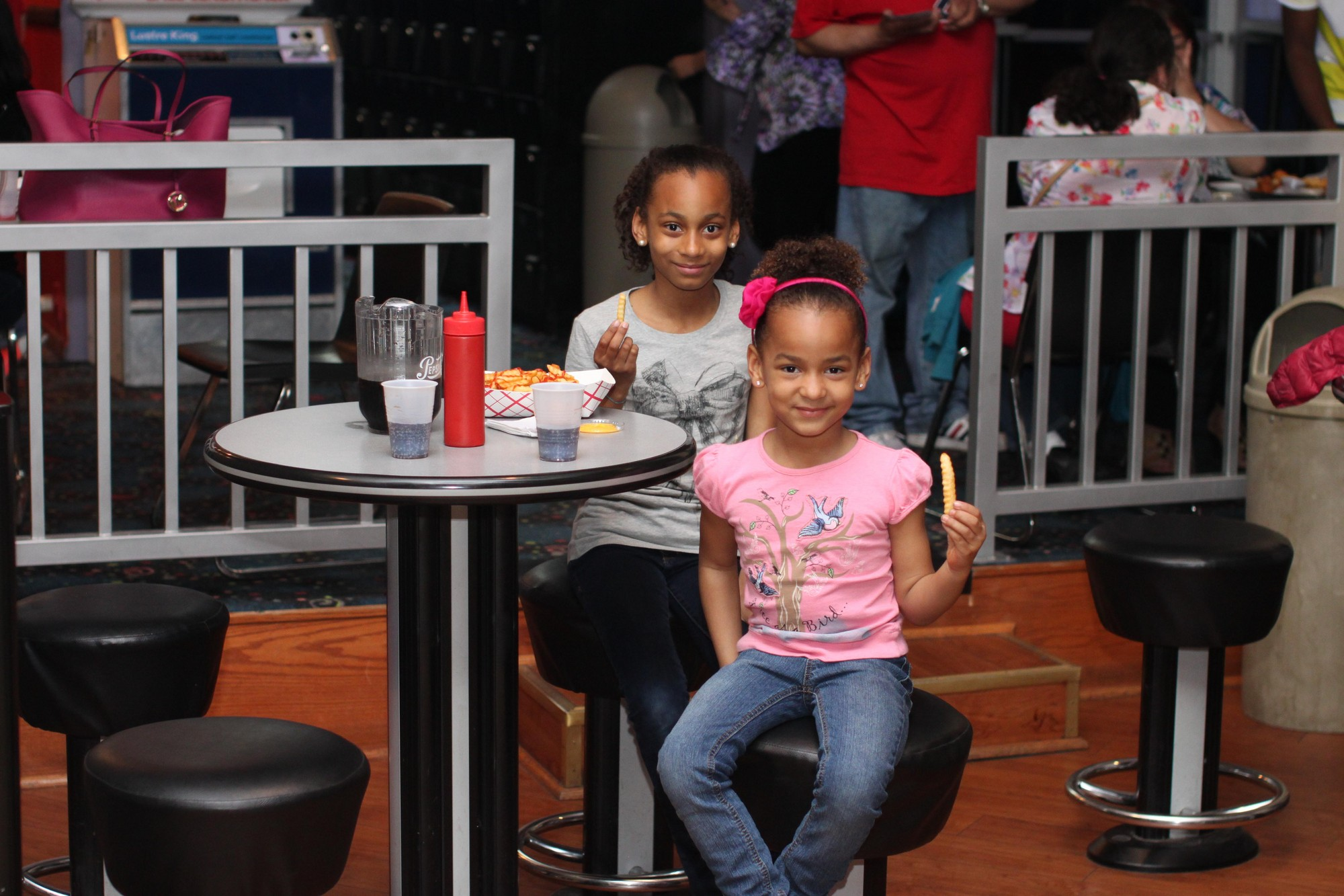 In addition to bowling the children enjoyed some snacks. Sisters Asia, 10, and India Campbell, 5, showed off their French fries.
