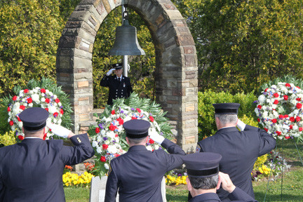 Lynbrook Fire Department members saluted at the Firefighters Memorial on Sunrise Highway.