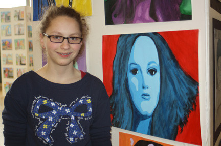 Eighth grader Sommer Schneller debuted her celebrity portrait of Adele in the Lynbrook South Middle School art show.