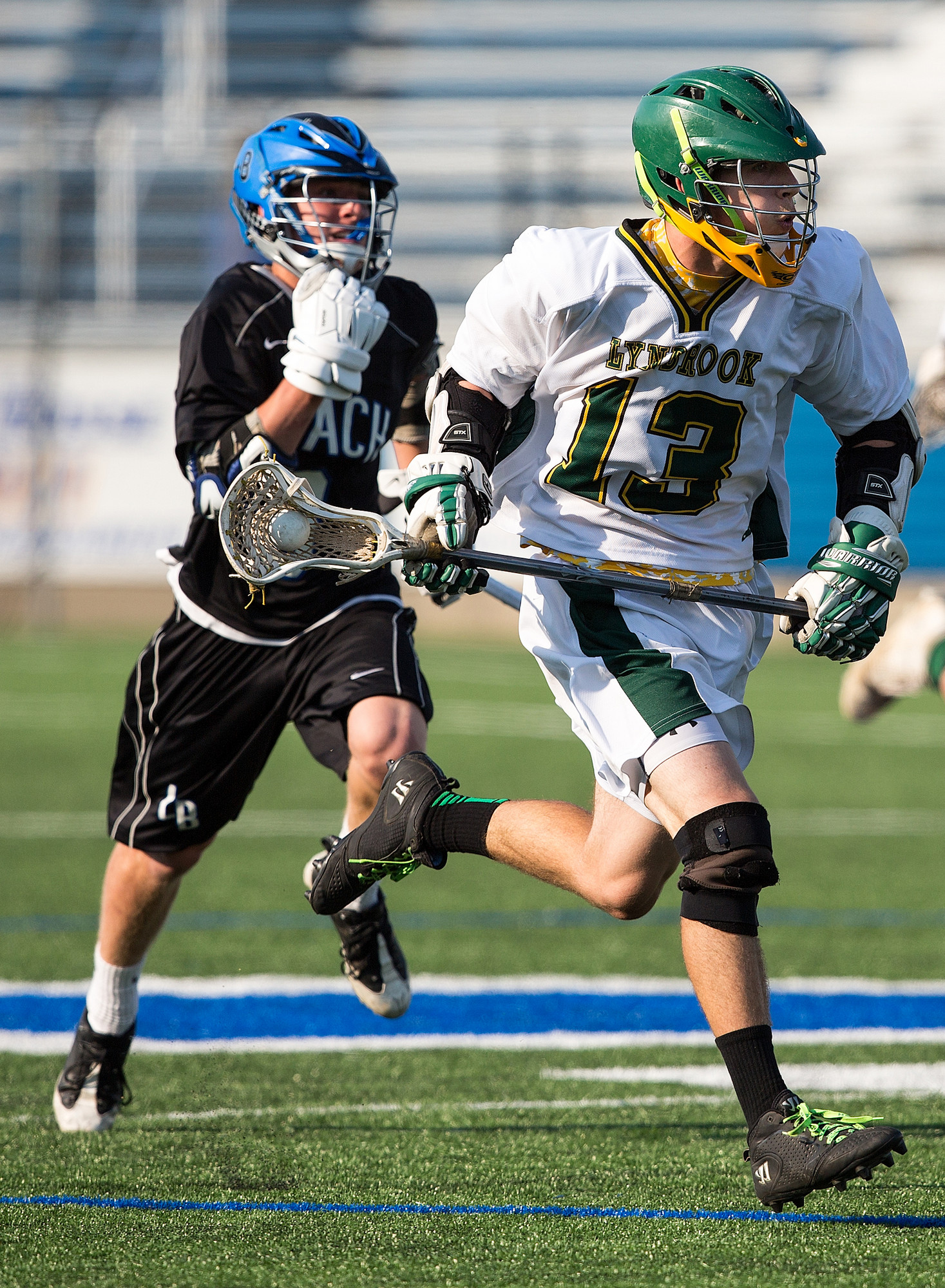 Lynbrook's Joe Grossi, right, raced upfield during the Owls' 8-4 Class B quarterfinal playoff defeat to Long Beach on May 16.