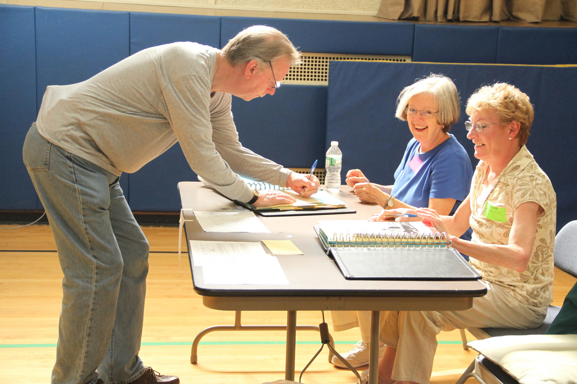 School Election workers Nancy Pirodsky and Kathleen Caiati got William Wheelwright signed in to vote Tuesday morning at the William L. Buck School where District 24�s $28.7 million budget was on the ballot.