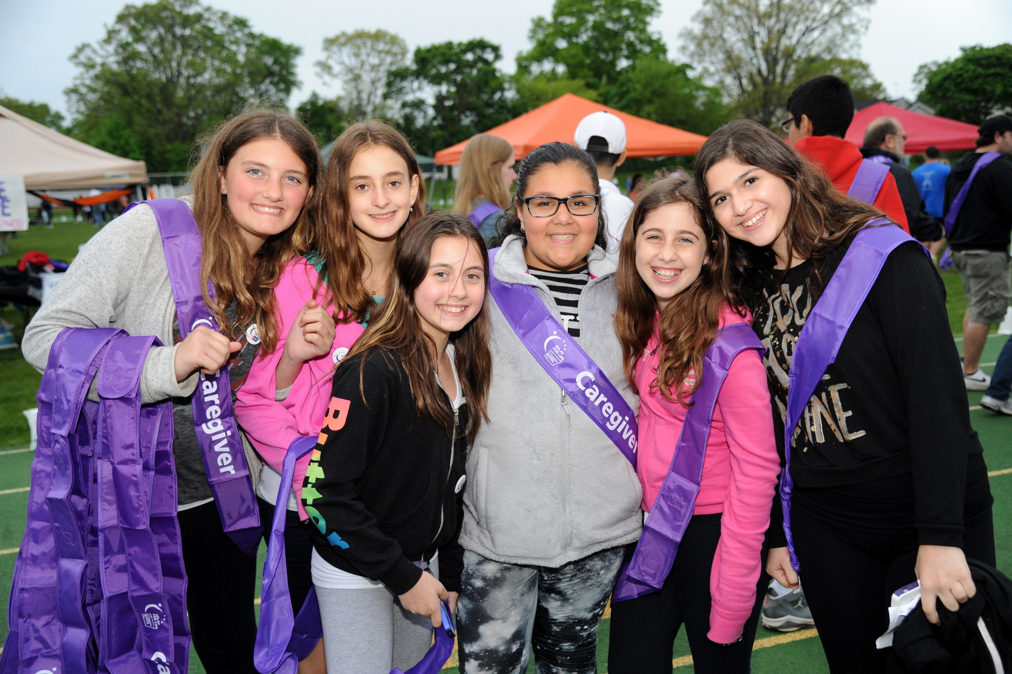 Woodmere Middle School Students Hailee Elias, 12, Gabby Brailouskiy, Alisa Feygis, all 12, Madison Cosentino, 11, and Ashley Shanaband  Julia Gueli, both 12, walked as caregivers.