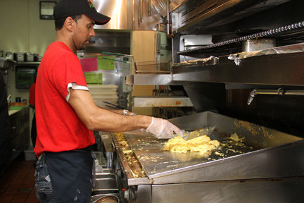 Applebee�s employees cooked the breakfast meals as students and other volunteers served the food. Above, Marcos Pereyra prepared the scrambled eggs.
