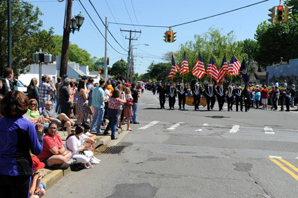 The East Meadow Fire Department Color Guard marched down Prospect Avenue toward Veterans Memorial Park at the conclusion of Monday's parade.