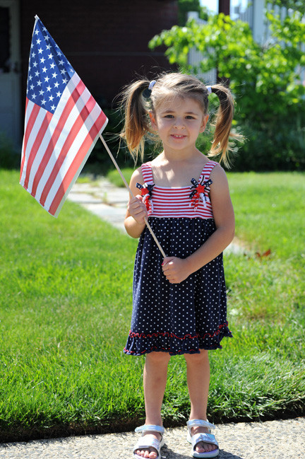 Anna McCardell, 3, dressed in red, white and blue.