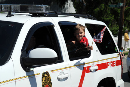 Ryan Salveson, 4, brandished the American flag while riding in the parade.