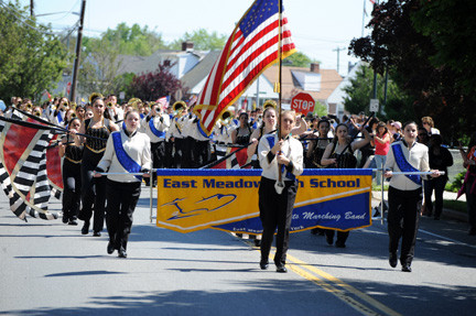The East Meadow High School band marched and performed on Monday.