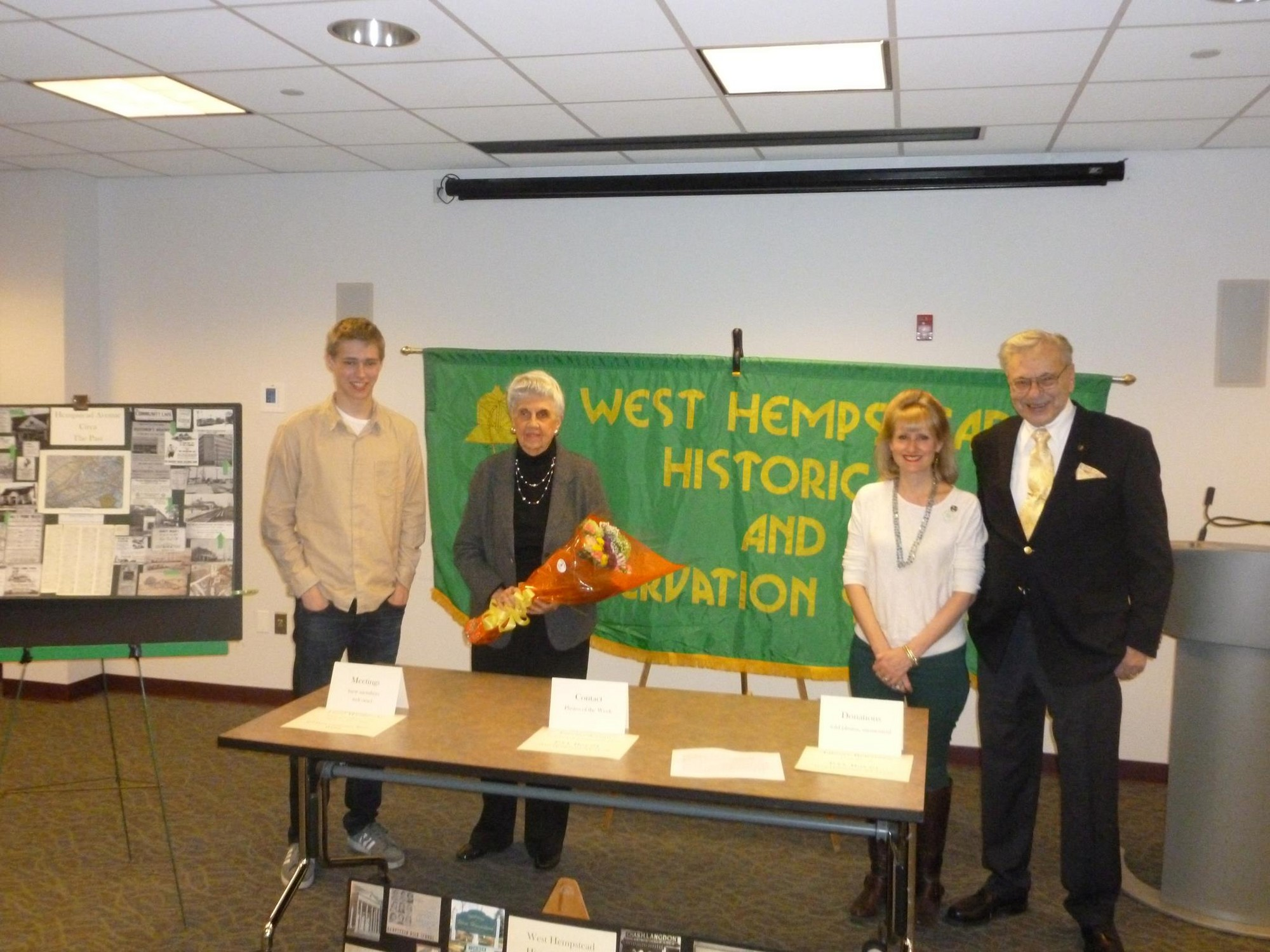 "Chris McAvoy hosted one of several presentations at the West Hempstead Public Library last March, entitled ""Helen Duryea Remembers…"" alongside Historical Society President John Shaud (far right)."