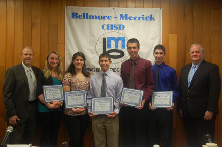 Members of the Mepham High School Physics Olympiad team recently took home the first-place overall trophy at the Long Island Physics Olympics at SUNY Farmingdale. Above, team members, center, from left, Nicole Altomare, Corryn Chaimowitz, Connor Garet, Brian Keohane and Matthew Waldmann, were honored at the May Bellmore-Merrick Central High School District Board of Education meeting. They were joined by their coach, Mepham physics teacher William Leacock, left, and Central District Superintendent Dr. Henry Kiernan.