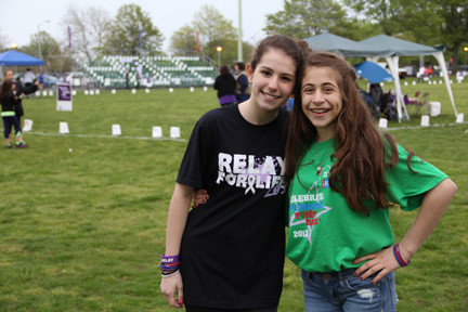 Michaela Cassella and Amanda Geist, students at Merrick Avenue Middle School, have raised $14,000 in donations for Relay For Life in the last three years.