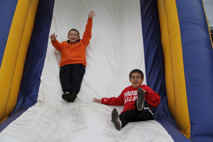 Max Unlu and Kenny Romeo took a break from the relay on the bouncy slide.