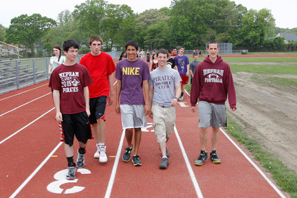 Sophomores Palmer Clare, Brendan Getzlor, Anand Bradley, Jon Spiegel and Nadav Franco, from left, joined more than 60 participants who came out to walk to help raise money for the victims of the Boston Marathon bombing.