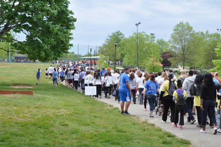 Hundreds walked in Eisenhower Park on May 18 to raise awareness for Angelman Syndrome.
