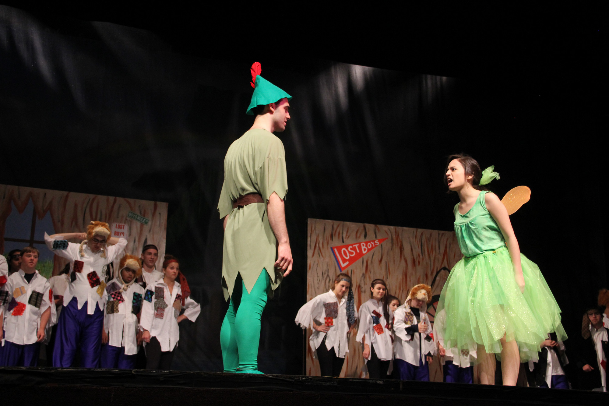 "Tink, played by Jackie Cano, yells at Peter Pan, John Manna, right before she sings a solo of ""We are Never Ever Getting Back Together"" Pictured in the background are the Lost Boys"