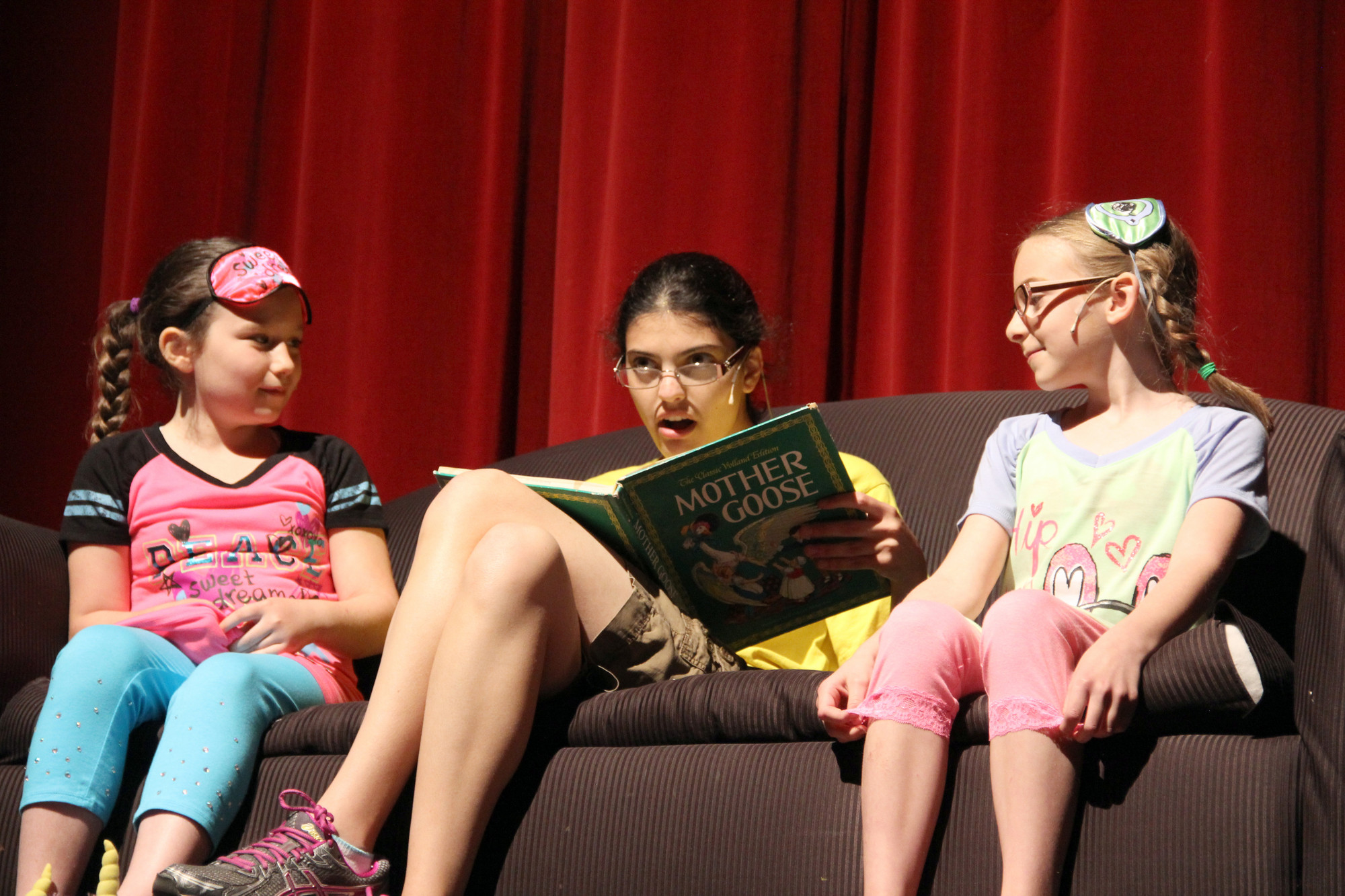Elizabeth, center, played by Josie DeMarco reads a bed time story to Victoria, Lila Naccari, and Julia, Lanie Prendergast.