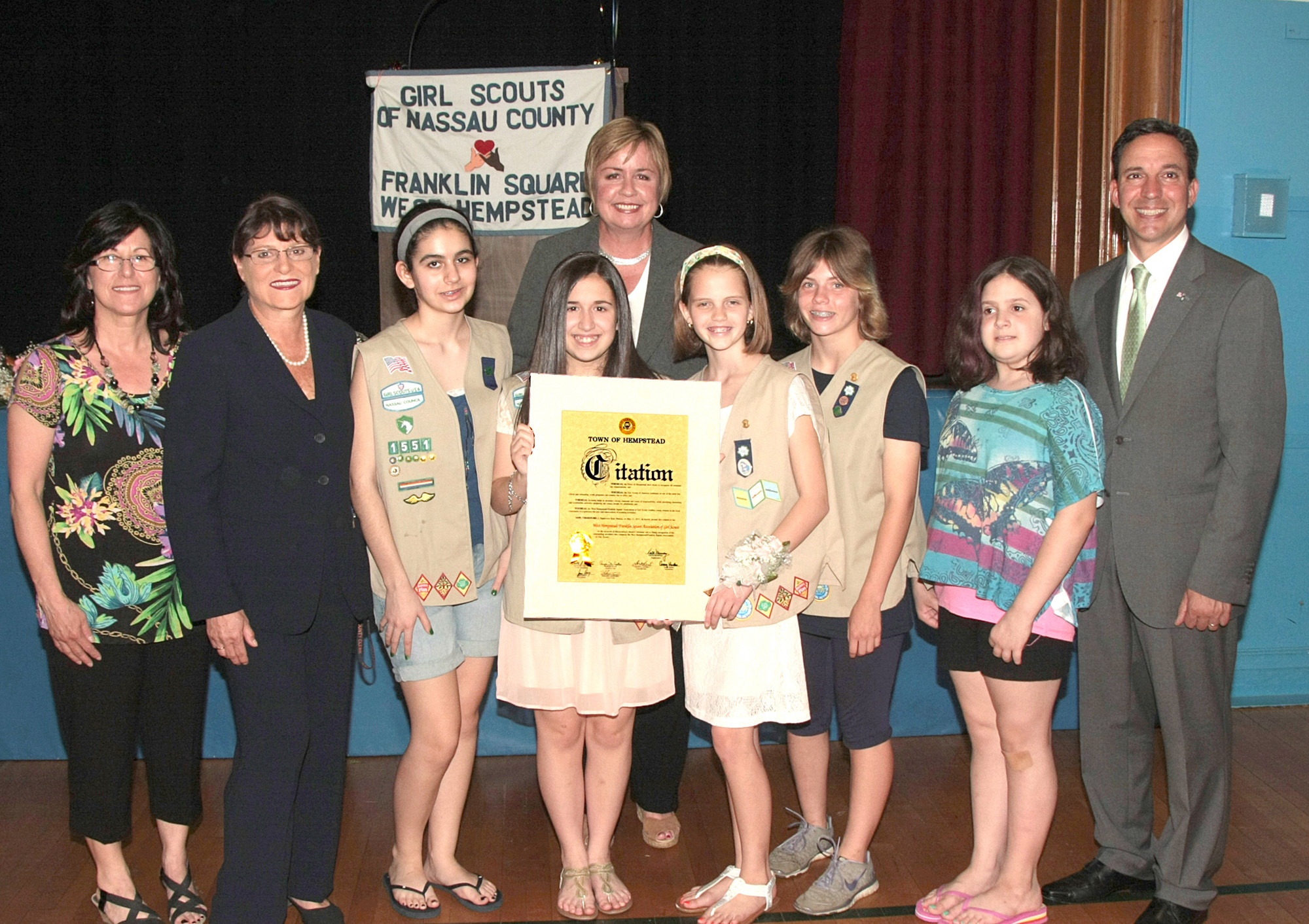 New York State Senator Jack Martins, Nassau County Clerk Maureen O'Connell, Town of Hempstead Supervisor Kate Murray recognize Troop 1551 with the Silver Award alongside Leader Liz Romano.