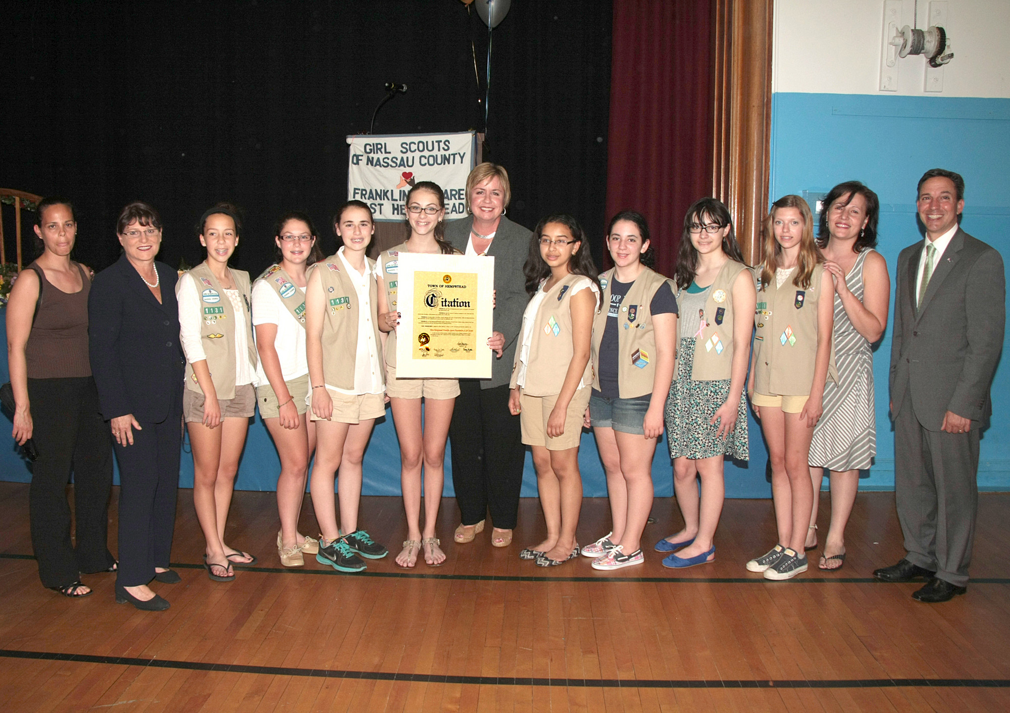 New York State Senator Jack Martins, Nassau County Clerk Maureen O'Connell, Town of Hempstead Supervisor Kate Murray with Troop 1345 Leader Carol Anne Stiklickas, Emily Stiklickas and Gold Awardee Sara Stiklickas.
