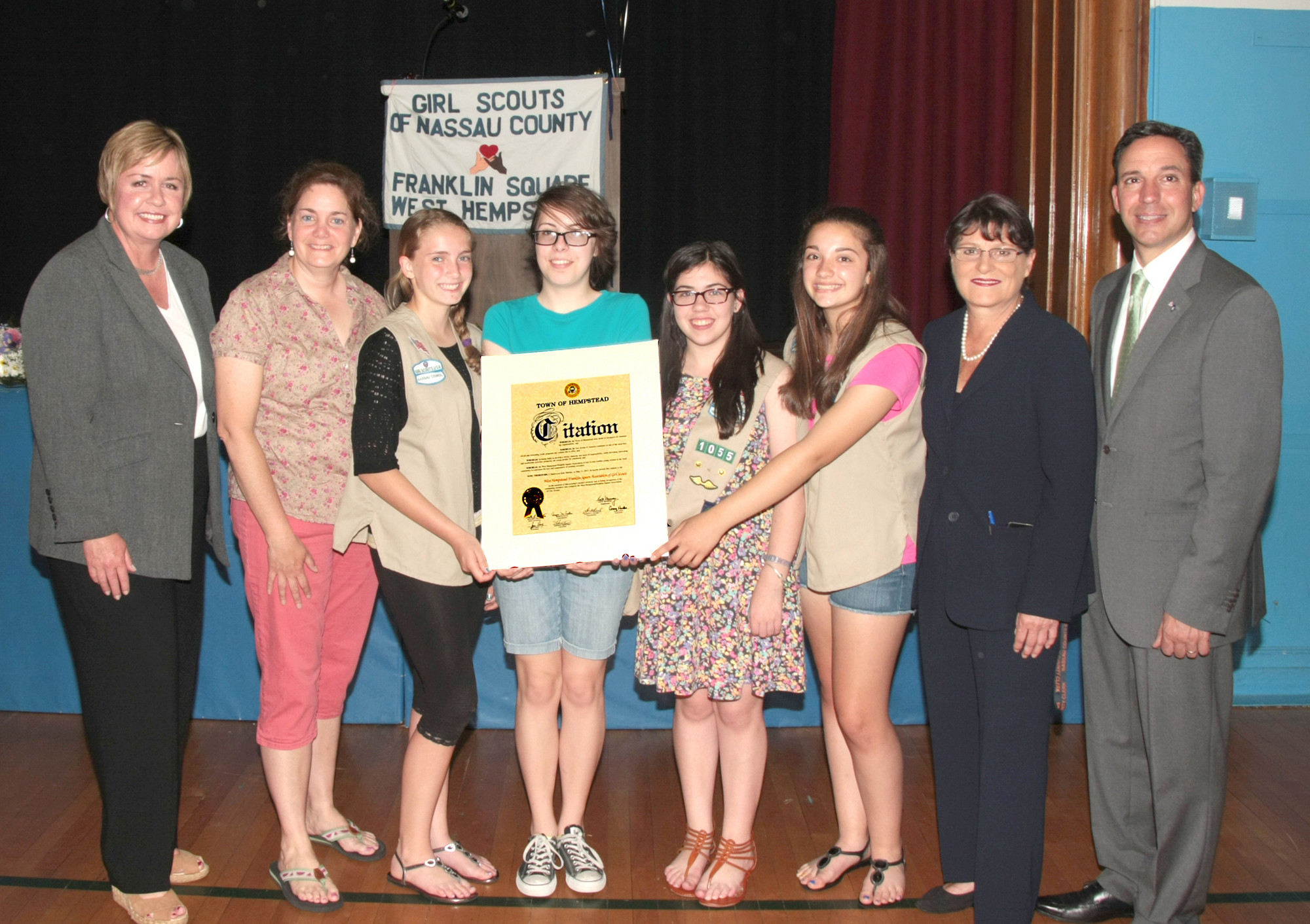 New York State Senator Jack Martins, Nassau County Clerk Maureen O'Connell, Town of Hempstead Supervisor Kate Murray congratulate Troop 1843 with the Silver Award alongside Leader Debbie DePalmo.