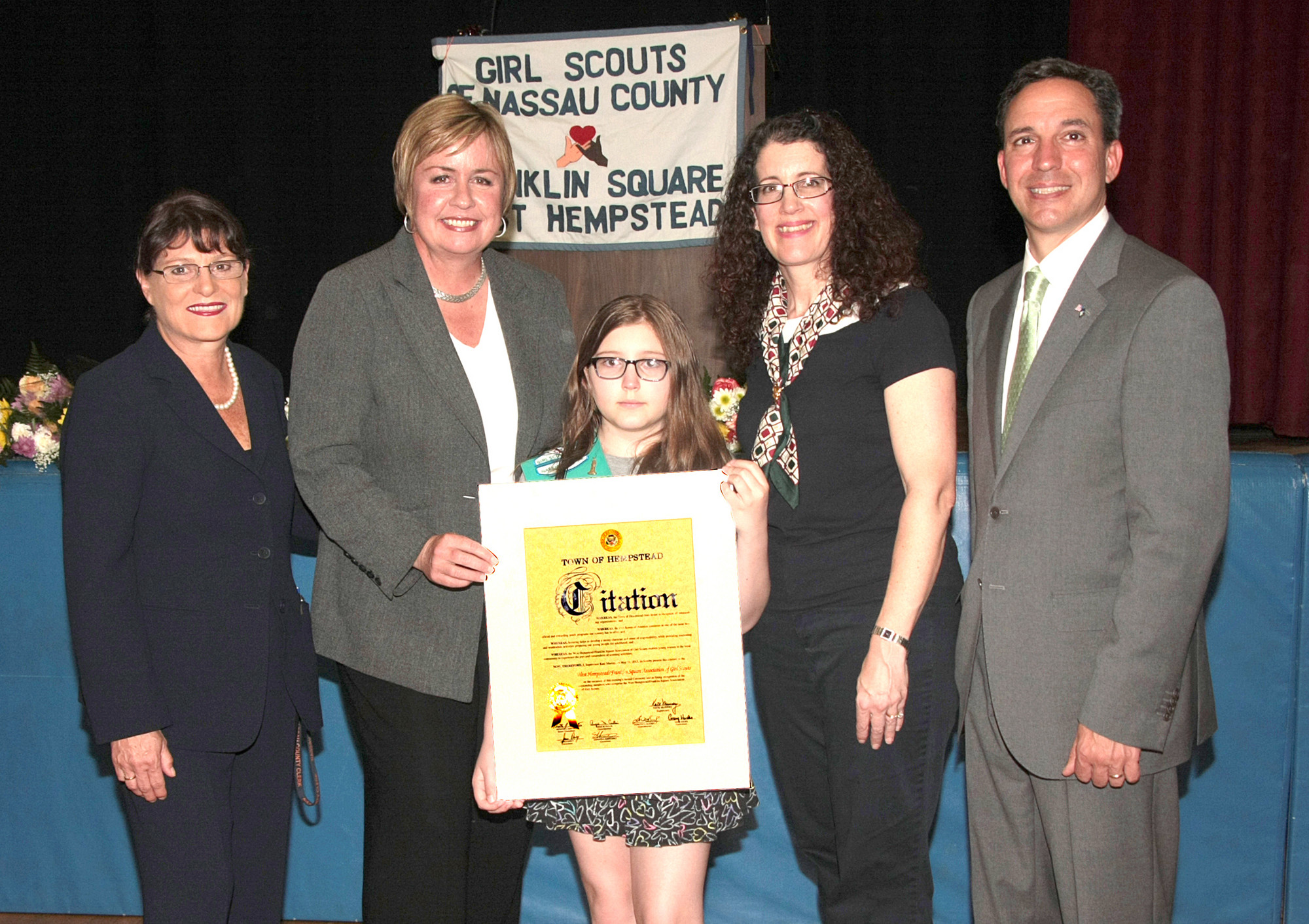 New York State Senator Jack Martins, Nassau County Clerk Maureen O'Connell, Town of Hempstead Supervisor Kate Murray congratulate Troop 1325 with the Bronze Award alongside Leader Peggy Asciutto.