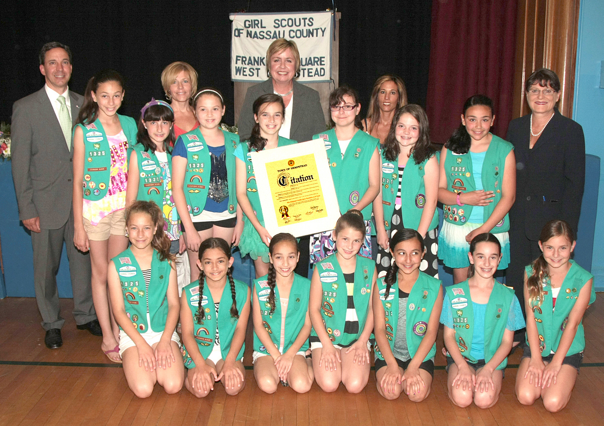 New York State Senator Jack Martins, Nassau County Clerk Maureen O'Connell, Town of Hempstead Supervisor Kate Murray congratulate Troop 1011 with the Bronze Award alongside Leader Rose Campos.