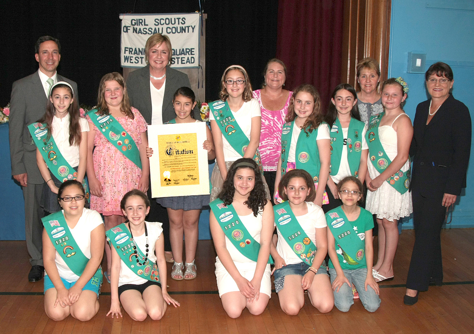New York State Senator Jack Martins, Nassau County Clerk Maureen O'Connell, Town of Hempstead Supervisor Kate Murray congratulate Troop 1345 with the Bronze Award alongside Leader Carol Anne Stiklickas and Bronze Awardee Jeri Stiklickas