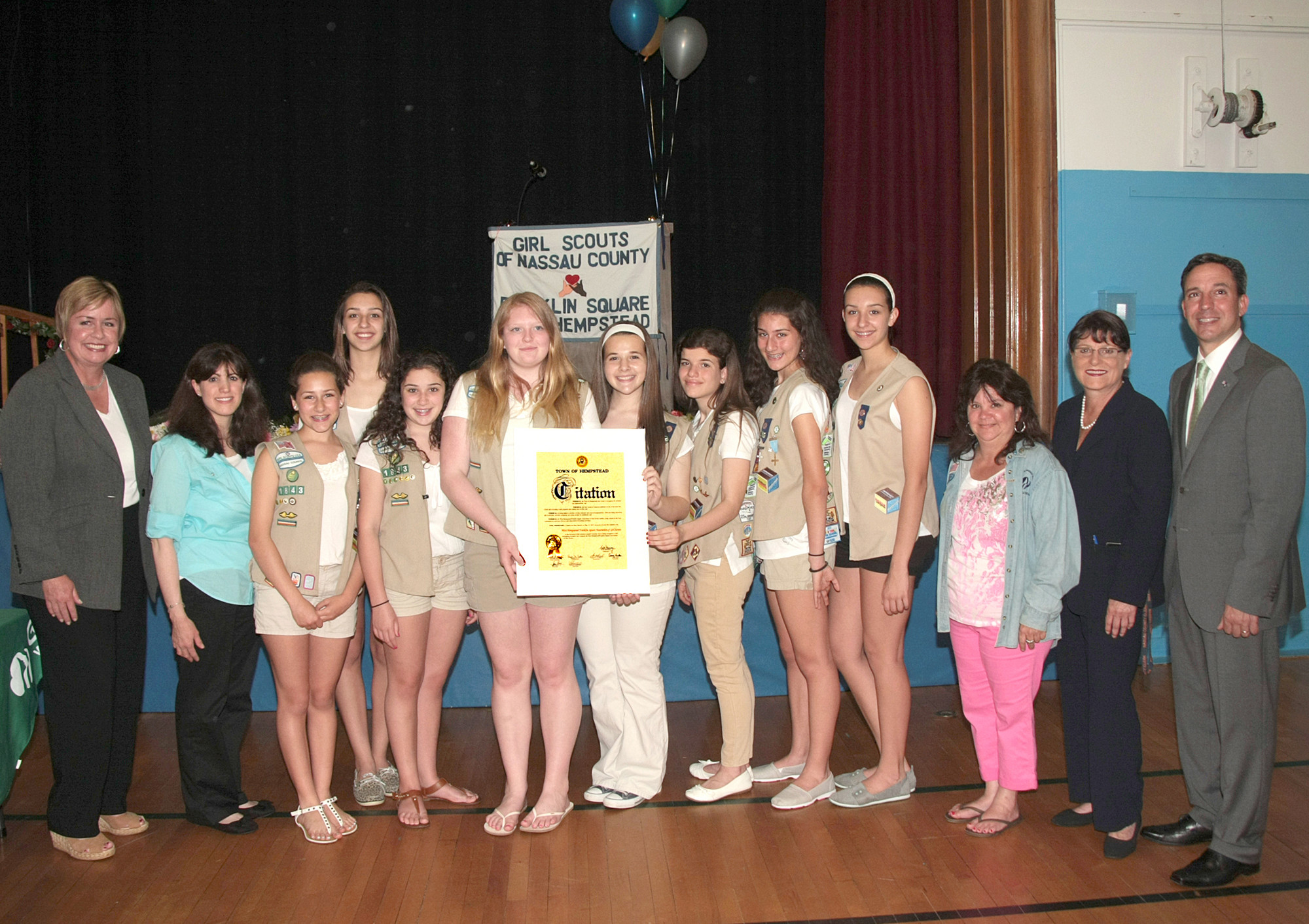 New York State Senator Jack Martins, Nassau County Clerk Maureen O'Connell, Town of Hempstead Supervisor Kate Murray congratulate Troop 1220 with the Bronze Award alongside Leader Janet Felter.