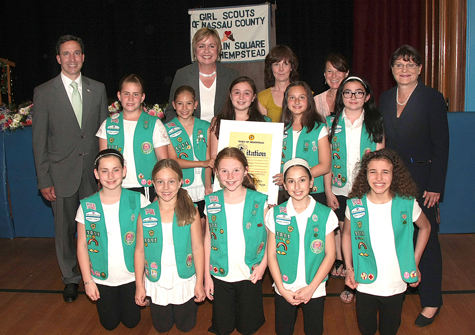 New York State Senator Jack Martins, Nassau County Clerk Maureen O'Connell, Town of Hempstead Supervisor Kate Murray congratulate Troop 1107 with the Bronze Award alongside Leader Lauren Bauman.