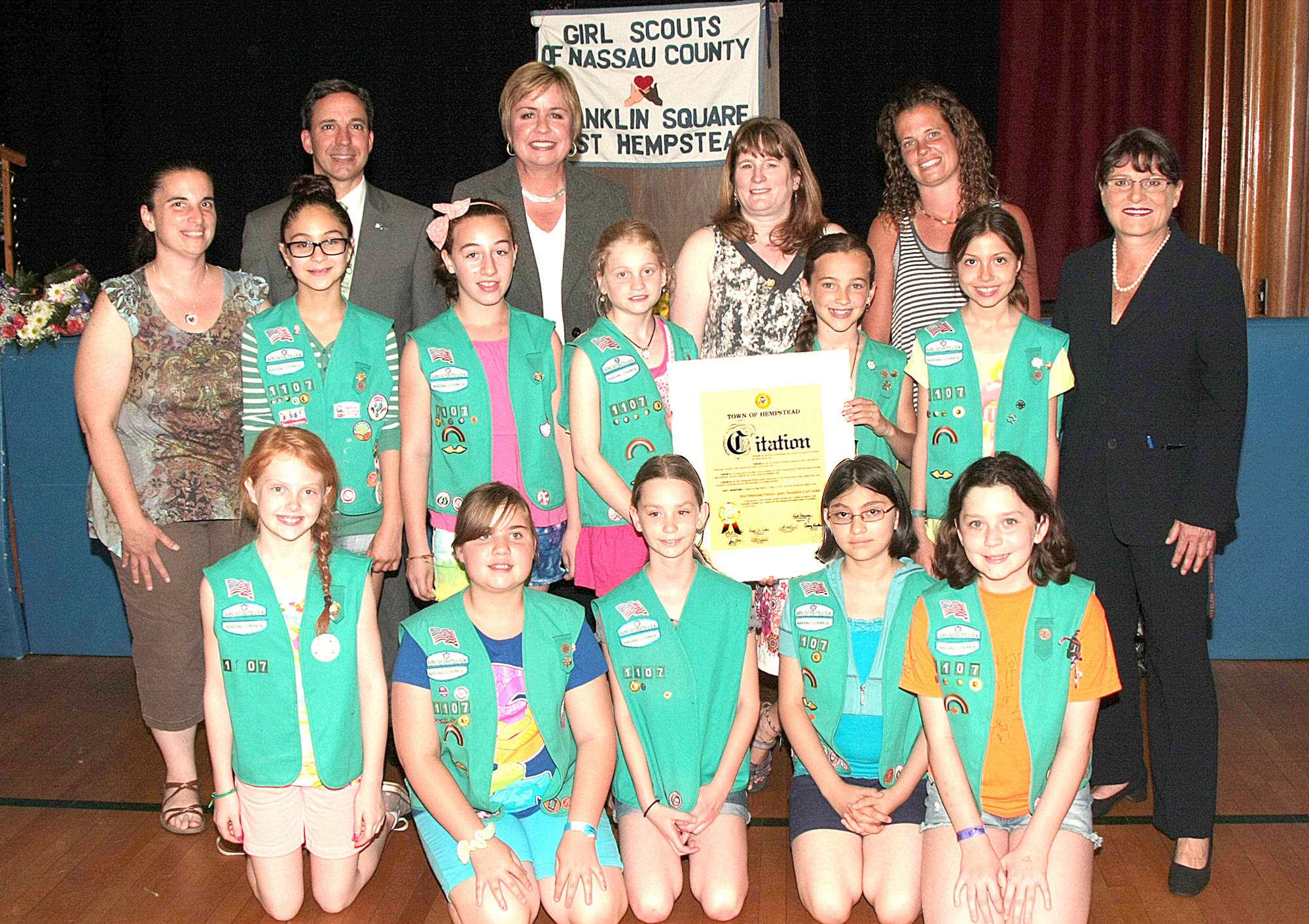New York State Senator Jack Martins, Nassau County Clerk Maureen O'Connell, Town of Hempstead Supervisor Kate Murray congratulate Troop 1055 with the Silver Award alongside Leader Ronnie Espey.