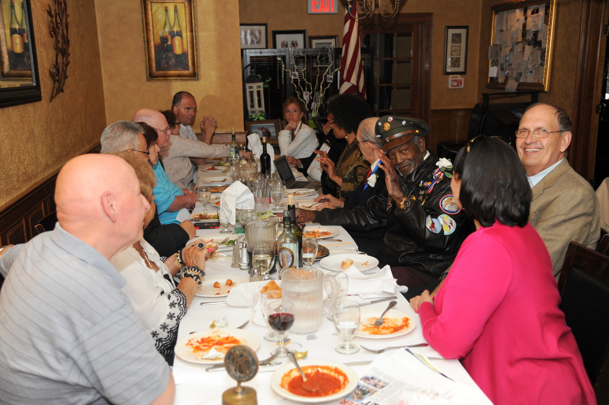 Kiwanis members dine and chat with some decorated heroes.