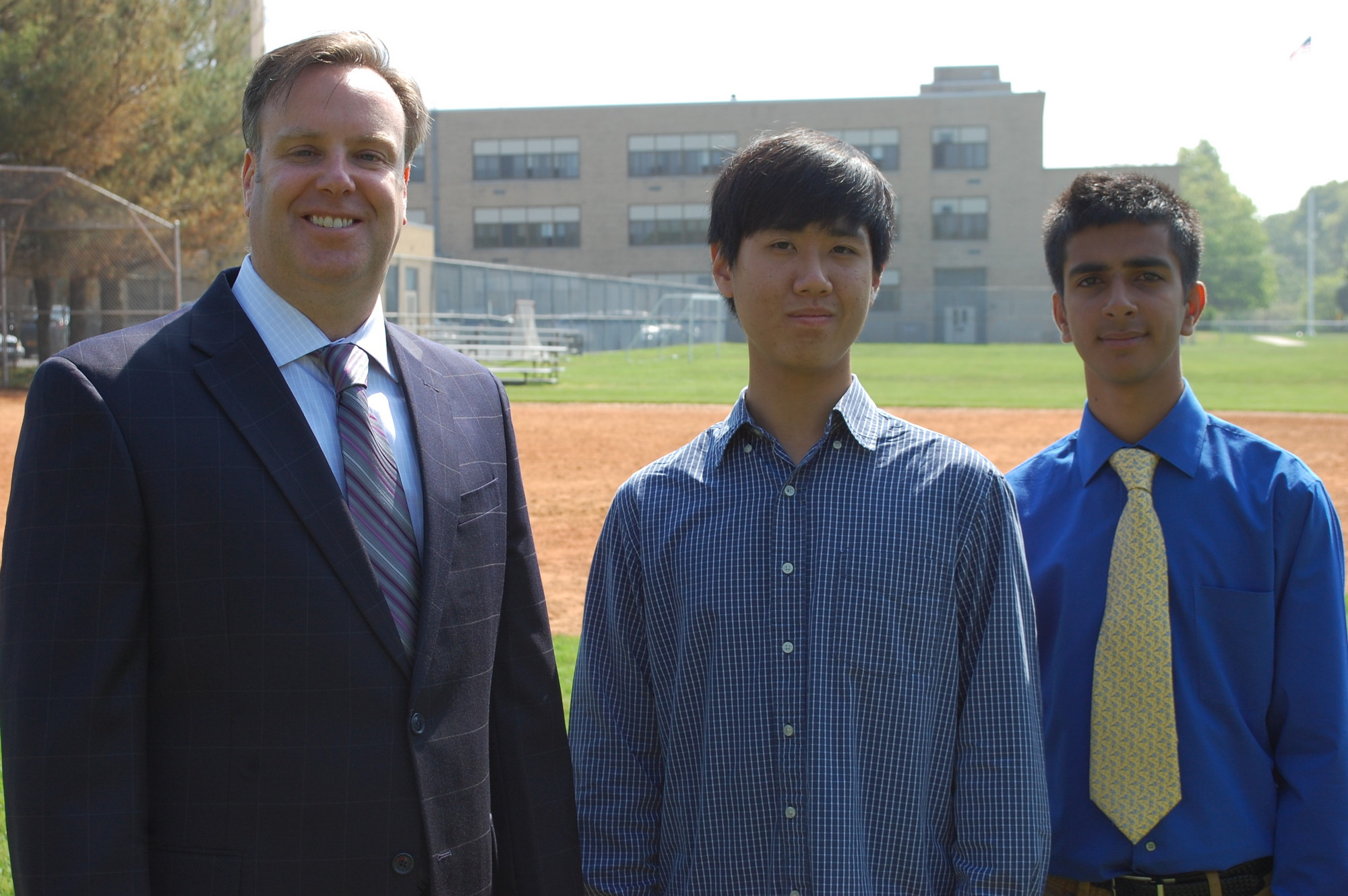 Jason Shen, center, and Rohan Motwani, right, are the top graduates of Central High School's class of 2013. They are joined by Superintendent Dr. Bill Heidenreich.