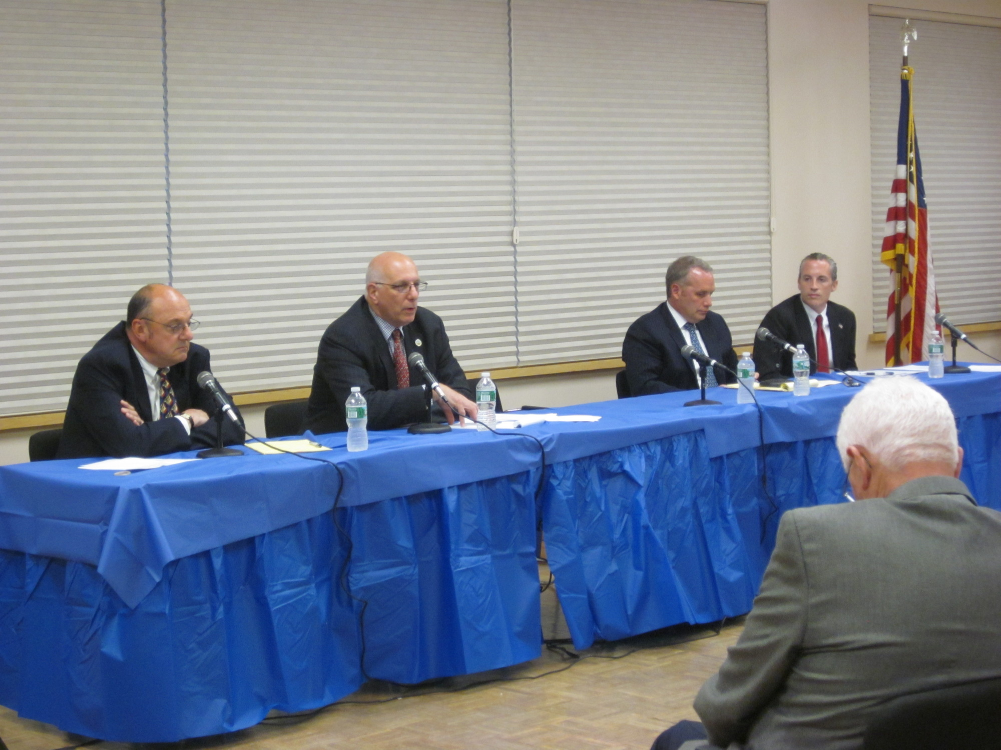 Candidates Mark Wieman, far left, Edward Oppenheimer, Emilio Grillo and Kevin Glynn discussed and debated their policies at the Sandel Senior Center Monday night.