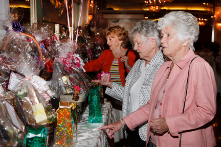 Many prizes were distributed during the evening. From left, Marion Reddington, Dolores Connolly and Palmer's mother, Anne Brennan, looked over the raffles.