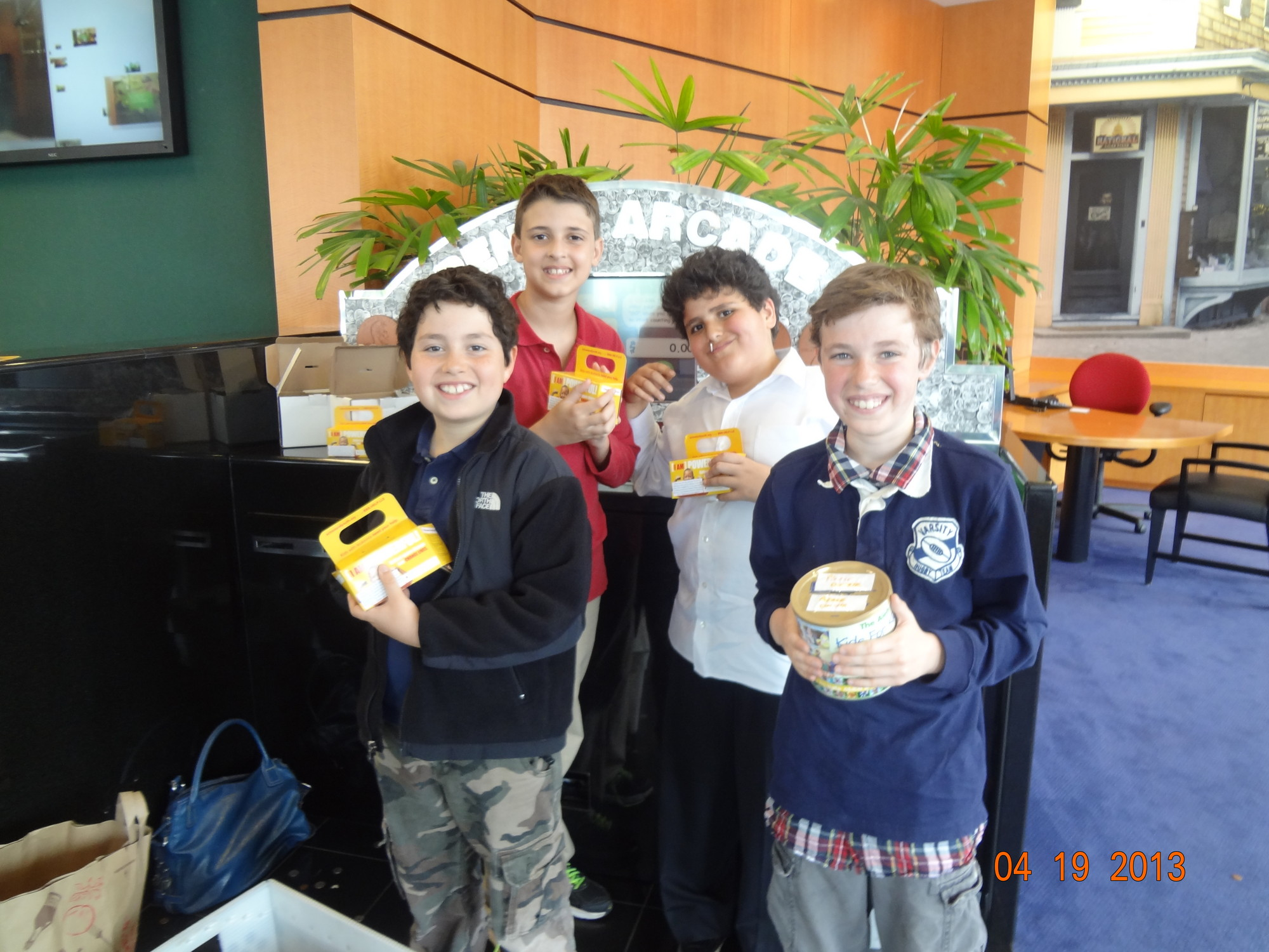 The Brandeis School collected nearly $2,000 for the Leukemia & Lymphoma Society's Pennies for Patients program. Fifth grade students Jacob Nessim, Brad Greissman, Yoni Glattman and Avi Nessim deposit the funds at TD Bank.